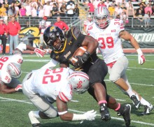 Towson running back Darius Victor barrels over a Stony Brook defender Saturday Oct. 4, 2014 at Johnny Unitas Stadium. (Aaron Saunders/ClubHouseAceS)